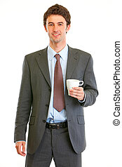 Portrait of happy modern businessman with coffee cup in hand