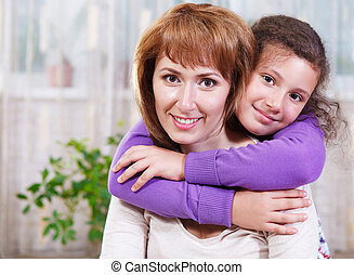 Portrait of happy mother and her little daughter
