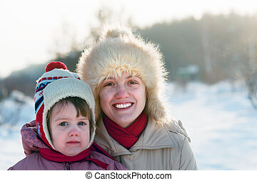 mother with child in winter park