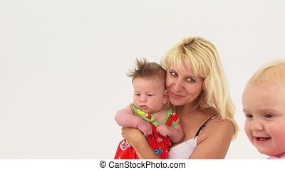 Portrait of Happy Mother  With Her Small Baby Posing For Camera