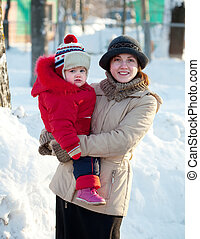 happy mother with toddler in winter