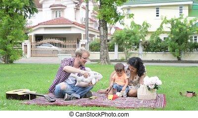 Portrait of happy multi-ethnic family bonding together...