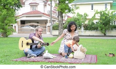 Portrait of happy multi-ethnic family bonding together with...