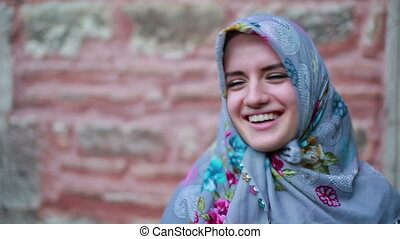 Portrait of happy muslim girl