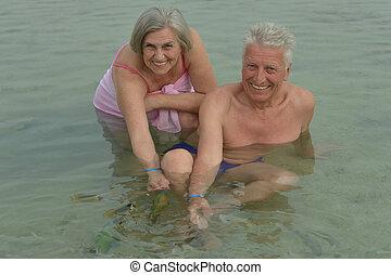 couple feeding fish