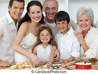 Portrait of happy parents, grandparents and children baking in the kitchen