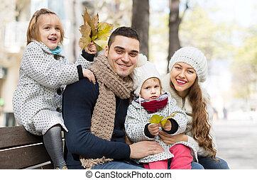 portrait of happy parents with children in autumn