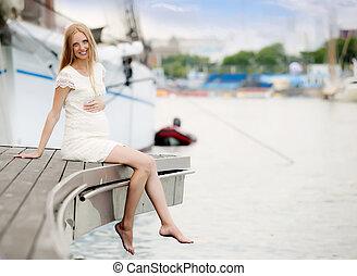 pregnancy woman sitting at port