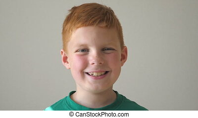 Portrait of happy red hair boy with freckles. Adorable baby...