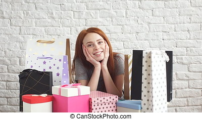 Portrait of Happy red-haired girl hugging a Box of gifts.