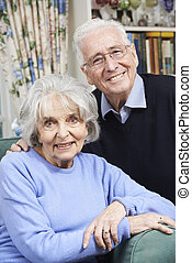 Portrait Of Happy Senior Couple At Home Together