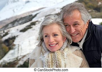 Portrait of happy senior couple at the mountain