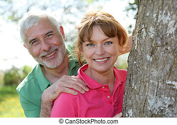 Portrait of happy senior couple in a park