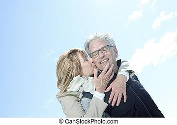 Portrait of happy senior couple in winter season