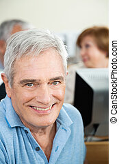 Portrait Of Happy Senior Man In Computer Class