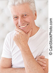 Portrait of happy senior man looking at camera - Happy ...