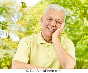 Portrait of happy senior man outdoors