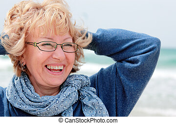 Portrait of happy senior woman at sea