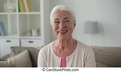 portrait of happy senior woman face at home