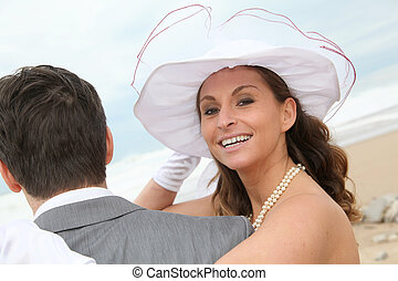 Portrait of happy smiling bride at the beach