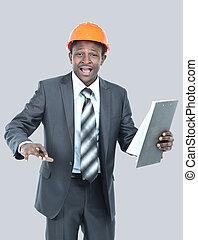 Portrait of happy smiling business man in helmet