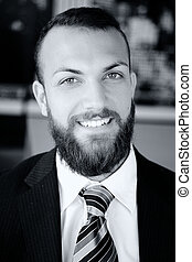 Portrait of happy smiling business man looking camera