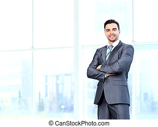Portrait of happy smiling businessman in a modern office