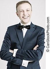 Portrait of Happy Smiling Caucasian Handsome Man in Blue Suite Against White.
