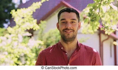 portrait of happy smiling man with beard outdoors