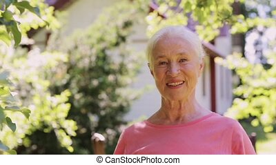 portrait of happy smiling senior woman outdoors