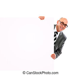 Portrait of happy smiling young business man showing blank signboard, isolated over white background