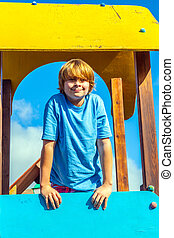 portrait of happy teenager at a playground