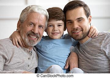Portrait of happy three different generations bonding male ...