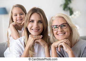 Portrait of happy three women generation grandma mom and child
