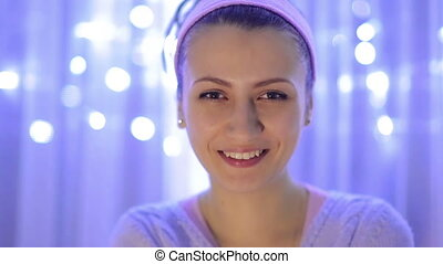 Portrait of Happy Woman at Christmas - smiling woman on the...