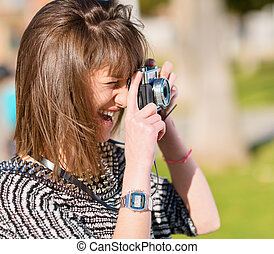 Woman Capturing Photo With Camera