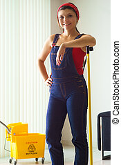 Portrait Of Happy Woman Doing Chores Cleaning Floor At Home