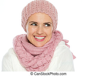 Portrait of happy woman in knit scarf, hat and mittens looking on copy space