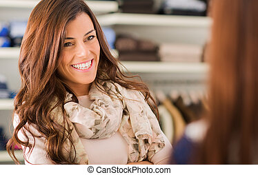 Portrait Of Happy Woman In Shopping Mall