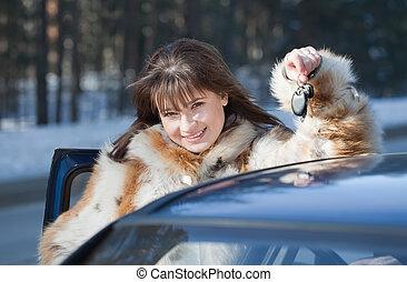 happy woman near her car