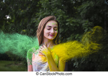 Portrait of happy woman on holi color festival