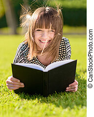 Happy Woman Reading Book In Park