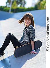 Happy Woman Sitting With Skateboard