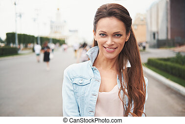 Portrait of happy woman standing in the street