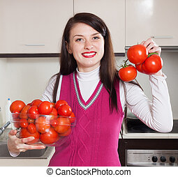 happy woman with red tomatoes