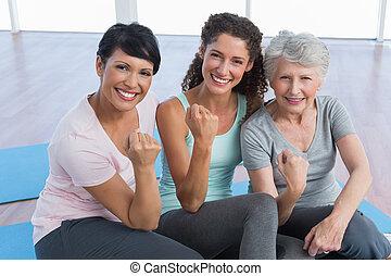 Portrait of happy women in yoga class