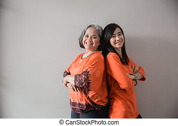 adult daughter with her senior mother
