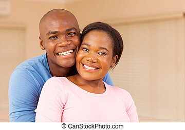 young african american couple indoors