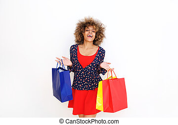 happy young african american woman holding shopping bags
