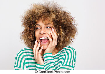 happy young african american woman laughing with hand on face